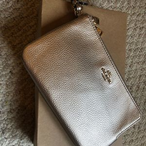 Nwt Stunning authentic gold coach wristlet.
